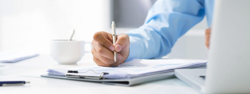 Close-up-of-male-hand-making-notes-in-office-1920x1281